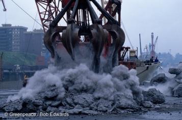 Ship unloading aluminium salt slag in Bilbao's Canal de Deusto. North Spain.